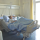 Woman lying in hospital bed humanizing healthcare